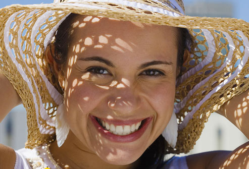 photolibrary_rf_photo_of_woman_wearing_sun_hat