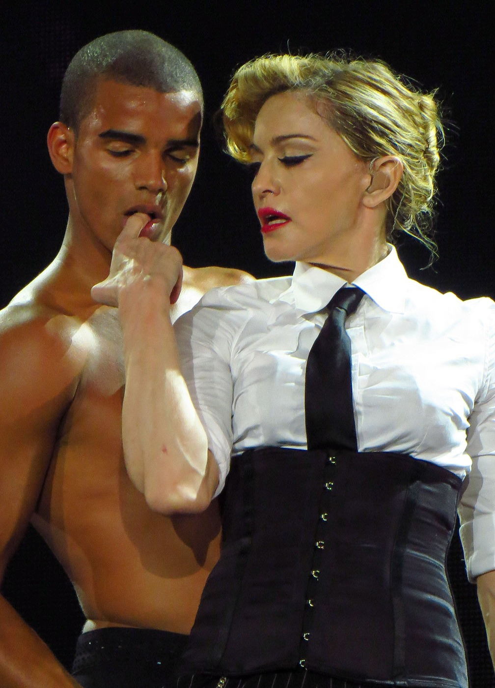 Queen of pop Madonna and her 25 year old boyfriend Brahim Zaibat seen sharing a passionate French kiss while on stage at the Telecom Stadium in Turkey