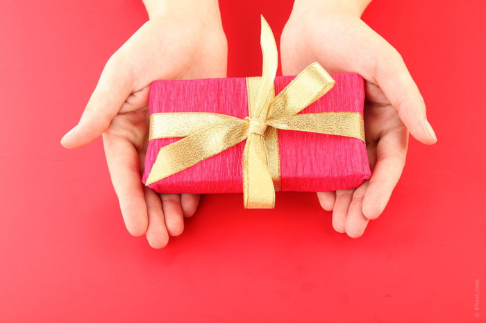 gift-present-valentines-christmas-idea-hands-give-easter-birthday