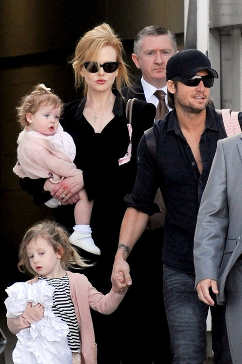 Nicole Kidman and husband Keith Urban arrive with their two adorable daughters Faith Margaret and Sunday Rose at Sydney Airport on Valentine's Day